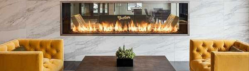 Fireplace with Yellow Interior | Jacobs Total Gas Services - Expert Propane & Natural Gas Installation Services in Naples, Marco Island, Bonita Springs & Estero