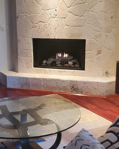 Fireplace with River Rock Accent   Jacobs Total Gas Services - Expert Propane & Natural Gas Installation Services in Naples, Marco Island, Bonita Springs & Estero